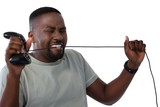 Frustrated man biting a wire of joystick - 175159404