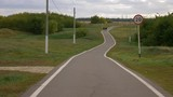 Winding long path way at country landscape. - 175162448