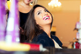 Portrait of a happy woman at the hair salon - 175166673