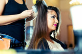 Portrait of a happy woman at the hair salon - 175166695
