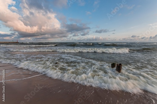 Fotobehang Strand Waves on Baltic coast - seascape at sunrise, Poland