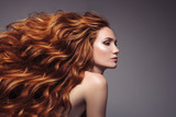 Portrait of woman with long curly beautiful ginger hair. - 175169407