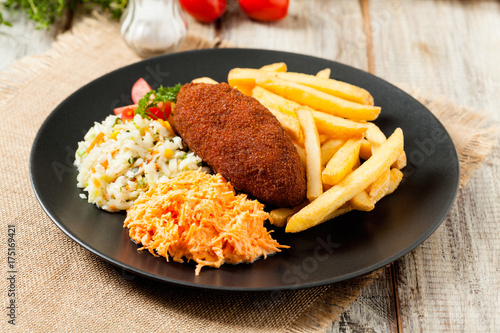 Fotobehang Kiev Chicken Kiev (de Volaille chop) with french fries and salads.