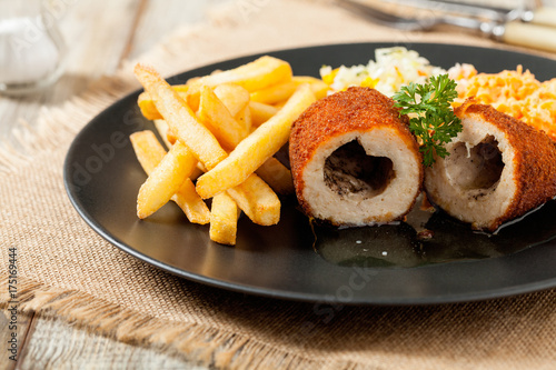 Deurstickers Kiev Chicken Kiev (de Volaille chop) with french fries and salads.