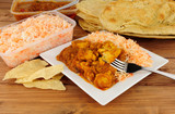 Indian curry take away meal with poppadoms and nan bread - 175171680