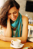 Portrait of beautiful 40 years old woman sitting in the cafe