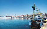 Fishing boat stands moored in port - 175177612