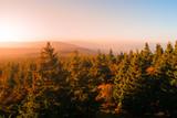 Autumn haze illuminated by sun above mountain peaks, Eagle Mountains, Orlicke hory, Czech Republic. - 175178209