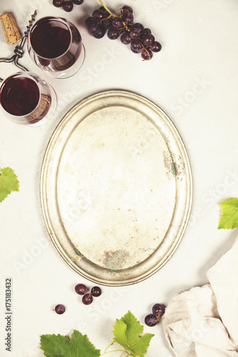 Wine and grapes over grey marble background