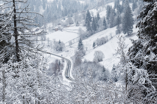 Aluminium Bleke violet Winding road in the mountains covered with snow