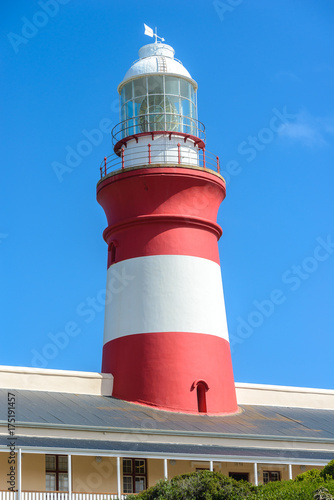 Fotobehang Vuurtoren The Cape Agulhas lighthouse at the most southern point in Africa, South Africa