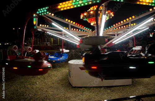 Fotobehang Amusementspark carousel at amusement park by night