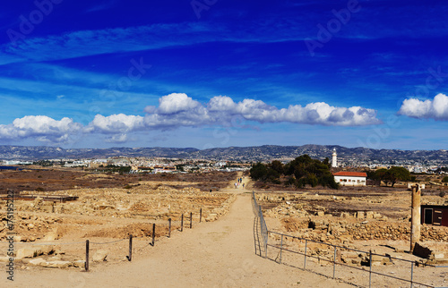 Poster Cyprus Ancient ruins of Kourion city near Pathos and Limassol, Cyprus. Ruins and road under blue sky. Travel outdoor background