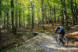 Cycling, mountain bikeing woman on cycle trail in autumn forest. Mountain biking in autumn landscape forest. Woman cycling MTB flow uphill trail. - 175199488