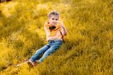 child sitting in park - 175204227