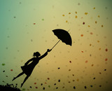 young girl flying away with an umbrella, autumn wind, - 175207460