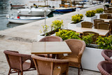 Cafe tables on the quay of Petrovac - 175212220