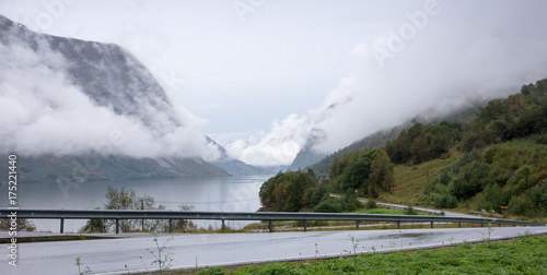 Poster Wit Foggy fjord scenery