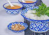 Thai rice vermicelli served with curry with Thai ancient pattern bowl and dish. - 175222870