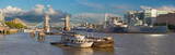London - The panorama of the Tower bridge, riverside and cruiser Belfast in evening light with the dramatic clouds. - 175225292