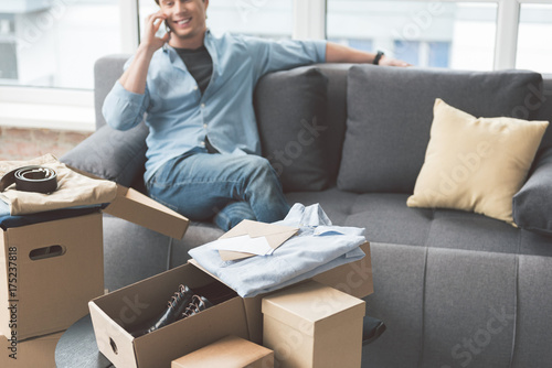Packages with shirts locating in apartment Poster