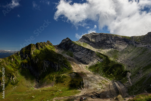 Fotobehang Nachtblauw Beautiful green mountain landscape with bright blue sky. North Caucasus.