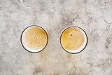 Two glasses of beer on grey stone background top view copyspace - 175260006