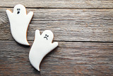 Halloween gingerbread cookies on grey wooden table - 175261024