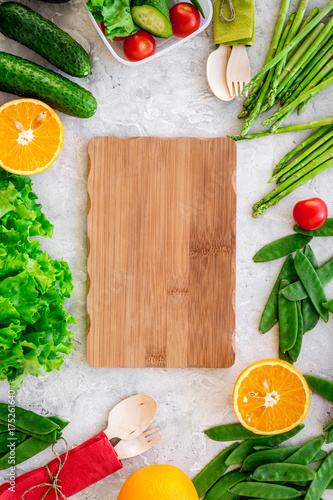 Mockup with healthy meal. Vegetables tomato, cucumber, asparagus, salad, pea on grey background top view