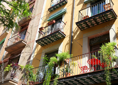 Spanish balconies decorated with pots with green plants
