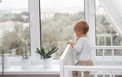 A child looks out the window  - 175262455