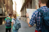 Tourist holding map and sightseeing in city - 175265254