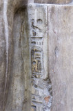 Ancient Egyptian hieroglyphs embossed in stone