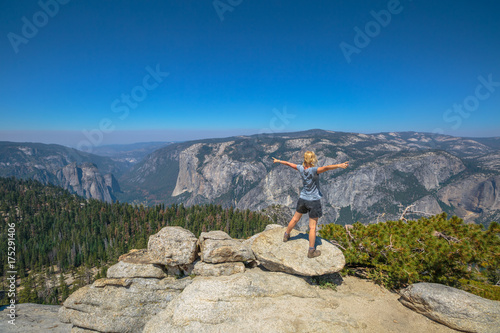 Yosemite summit panorama view for a woman after hiking in Yosemite National Park at Sentinel Dome Poster