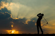 silhouette golfer playing golf during beautiful sunset - 175295297