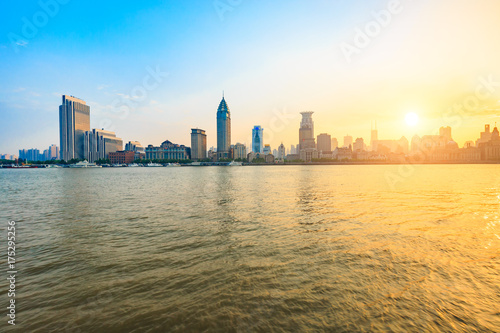 Huangpu River and modern city scenery in Shanghai at sunset Poster
