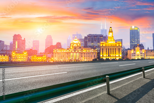 Asphalt road and modern cityscape in Shanghai at sunset Poster