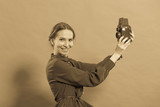 Woman taking picture with old camera - 175299678