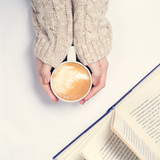 Girl holding cup of coffee with latte art. Leasure time concept. Pastel colors - 175299846