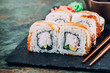 Eel fish sushi roll maki - japanese food - selective focus