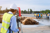 Surveyor engineers using an altometer at Construction Site. - 175304879