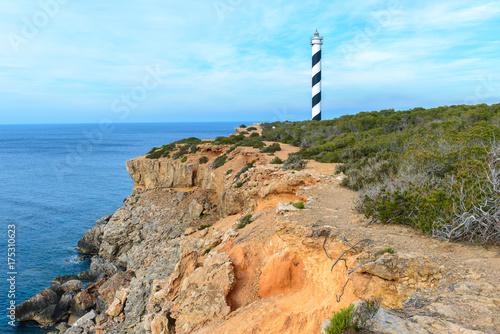 Moscarter lighthouse at the north coast of Ibiza island, Spain