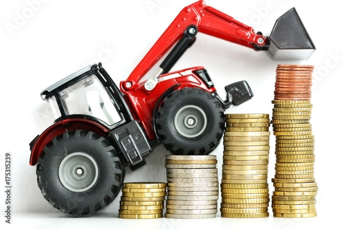 Fotobehang Trekker Red tractor climbing stairs of money suggesting growing costs in agriculture