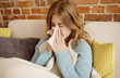 Young woman with cold, flue.