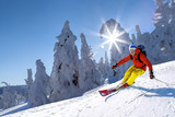Skier skiing downhill in high mountains against blue sky - 175319854