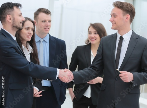 business team looks at the handshake business partners