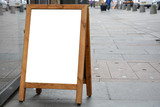 Blank ad space on wooden stand in the street - 175327006