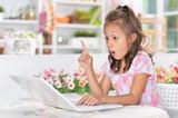 Little girl using laptop - 175335840