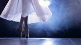 Ballerinas feet as she makes pointe arabesque steps.  - 175336288