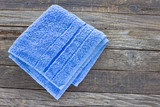 Blue towel on wooden background - 175337246